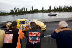 Fans look on as Marcos Ambrose heads back to the garage