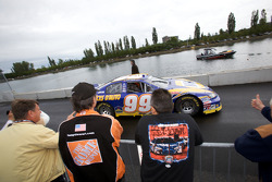 Fans watch as Patrick Carpentier heads back to his garage