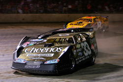 Clint Bowyer, driver of the #33 Cheerio's Chevrolet leads a pack of cars