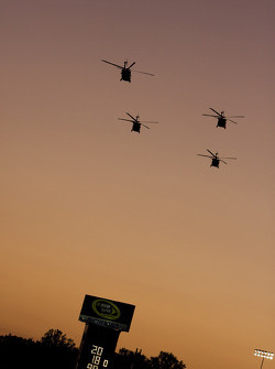 Helicopters fly over