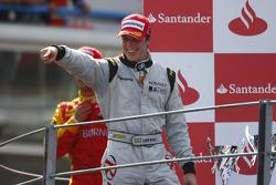 Luiz Razia celebrates his victory on the podium