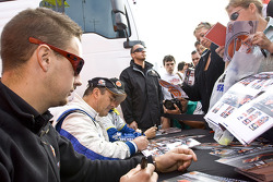 Lawrence Tomlinson, Nigel Mansell, Greg Mansell sign autographs