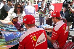 Kimi Raikkonen, Ferrari and Sebastian Vettel, Ferrari sign autographs for the fans
