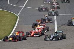 Daniel Ricciardo, Red Bull Racing RB12 and Nico Rosberg, Mercedes AMG F1 Team W07 lead at the start of the race