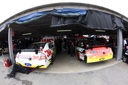 The No. 16 of Greg Biffle and the No. 24 of Jeff Gordon are worked on