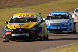 Gordon Shedden leads Mat Jackson and Jonny Adam