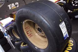 A crew member checks tires