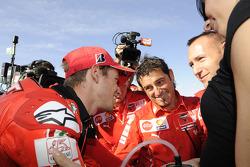Pole winner Casey Stoner, Ducati Marlboro Team celebrates