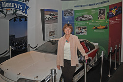 St. James shown with her record-breaking car, which she owns and has on display at the exhibit