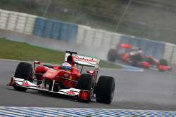 Fernando Alonso, Scuderia Ferrari, F10 leads Jenson Button, McLaren Mercedes, MP4-25