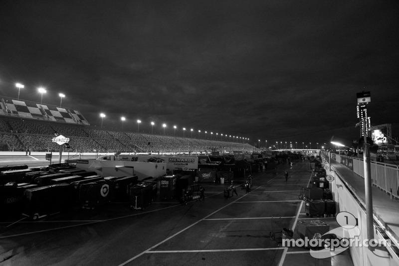 A wet Daytona International Speedway at dusk