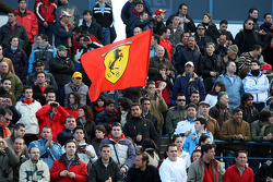 Fans in the crowd with a Ferrari flag