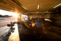 Mechanics work on the cars of Max Chilton and Adriano Buzaid