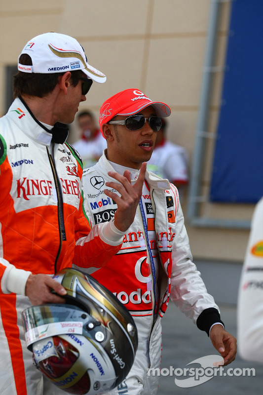 Adrian Sutil, Force India F1 Team y Lewis Hamilton, McLaren Mercedes