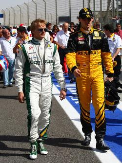 Heikki Kovalainen, Lotus F1 Team with Robert Kubica, Renault F1 Team