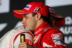 Podium: race winner Jenson Button, McLaren Mercedes, third place Felipe Massa, Scuderia Ferrari