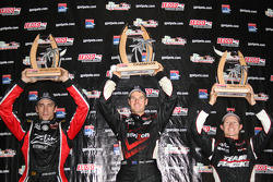 Podium: race winner Will Power, Team Penske, second place Justin Wilson, Dreyer & Reinbold Racing, third place Ryan Briscoe, Team Penske