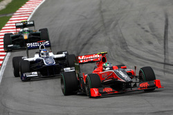 Lucas di Grassi, Virgin Racing leads Rubens Barrichello, Williams F1 Team
