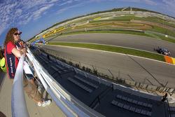 An Audi Sport fans watches as Mattias Ekström, Audi Sport Team Abt Audi A4 DTM drives by