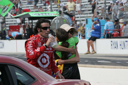 Dario Franchitti, Target Chip Ganassi Racing finishes the winner's milk as Danica Patrick, Andretti Autosport hugs Ashley Judd