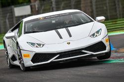 Andrea Dovizioso, Casey Stoner, Ducati Team en un Lamborghini