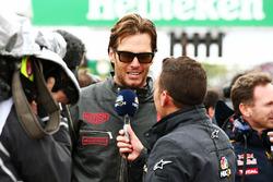 Tom Brady, New England Patriots Quarterback with Will Buxton, NBC Sports Network TV Presenter on the grid