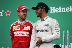 (L to R): Sebastian Vettel, Ferrari with race winner Lewis Hamilton, Mercedes AMG F1 on the podium