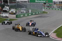 Marcus Ericsson, Sauber C35 leads Kevin Magnussen, Renault Sport F1 Team RS16 and Lewis Hamilton, Mercedes AMG F1 W07 Hybrid