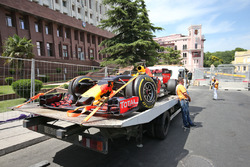 The Red Bull Racing RB12 of Daniel Ricciardo, Red Bull Racing is recovered back to the pits on the back of a truck