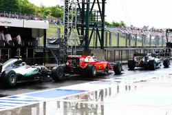 Lewis Hamilton, Mercedes AMG F1 W07 Hybrid leads Kimi Raikkonen, Ferrari SF16-H and Nico Rosberg, Mercedes AMG F1 W07 Hybrid in the pit lane
