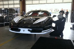 Rudy Courtade gives some attention and shows the love for the Auto Gallery Motorsports Ferrari 458