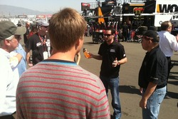 Jeremy Clements speaks with some of the Vista Paint VIP's