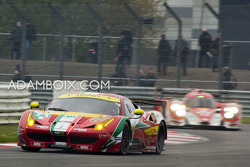 Ferrari leads the Rebellion thru Copse