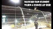 Un fan grimpe le grillage lors d'une course de NASCAR