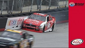 Reed clips the wall in turn 1, loses a tire